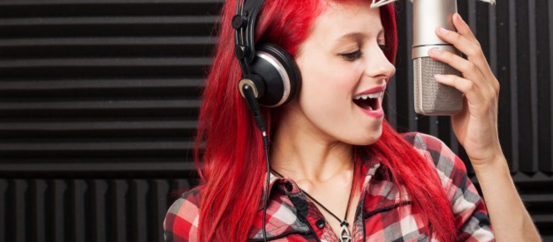 happy-girl-recording-a-song_1149-1032