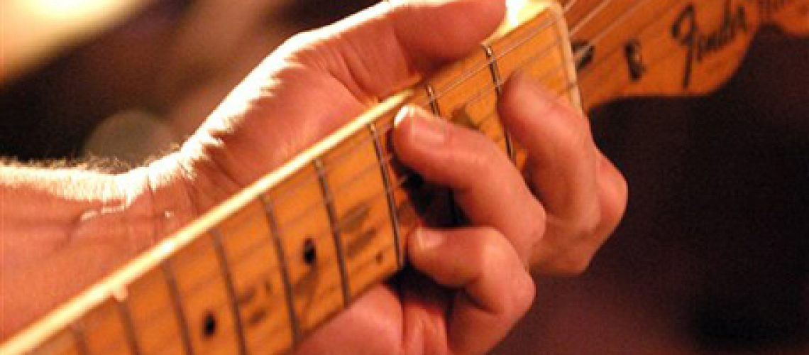 Steve Allen of the Long Players fingers the fret board during a show featuring the playing of Bob Dylan's album